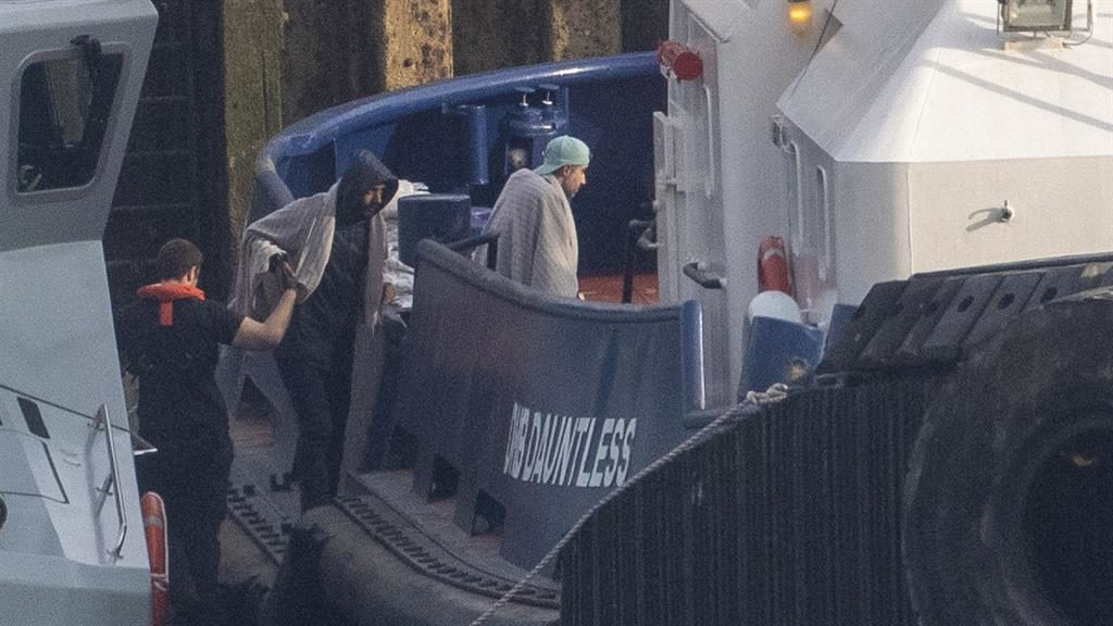 Helped ashore: The migrants arrive in Dover for questioning PICTURE: SPLASH