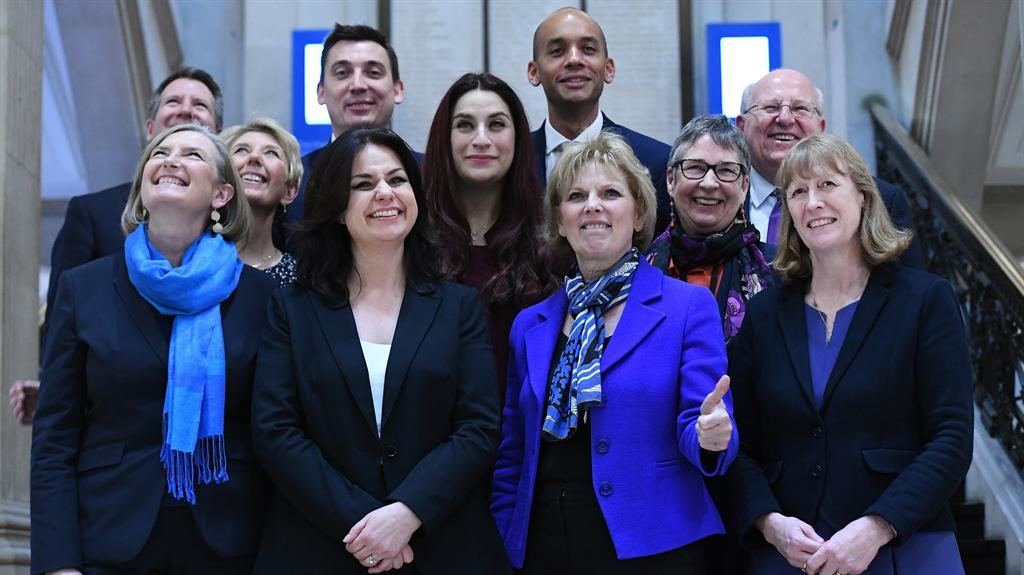 Breakaway blues: The Independent Group of MPs pose for the cameras PICTURE: EPA