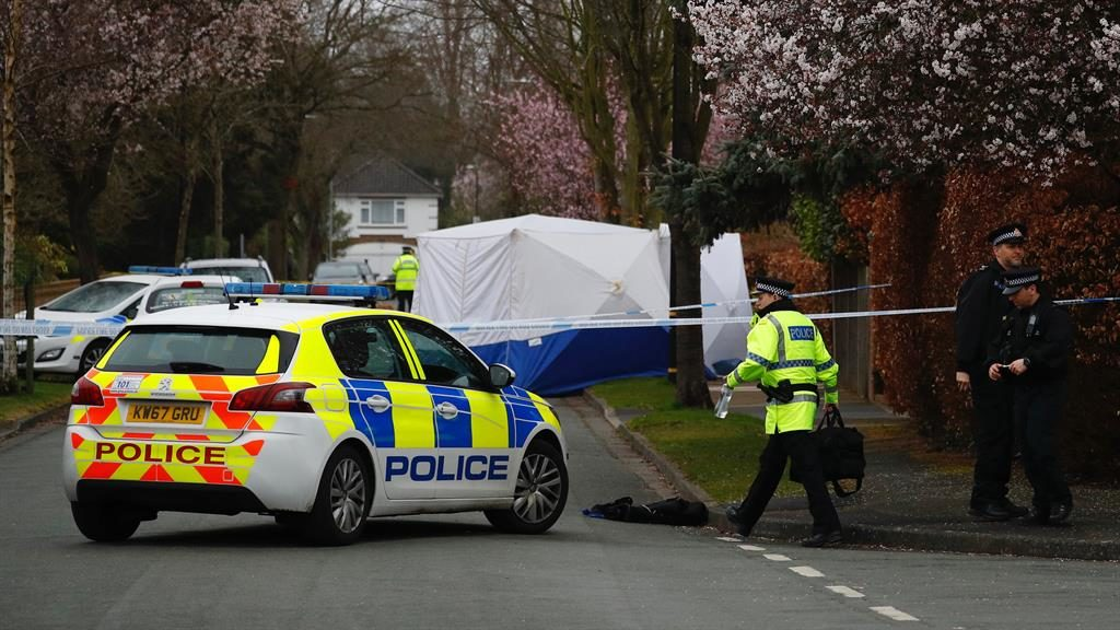 Crime scene: Police at spot where Yousef Makki was stabbed to death PICTURE: PA