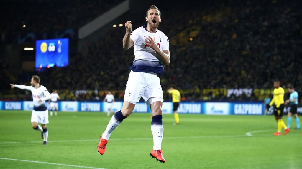 Leading man Kane celebrates his goal which eased Spurs' path into the quarter-finals