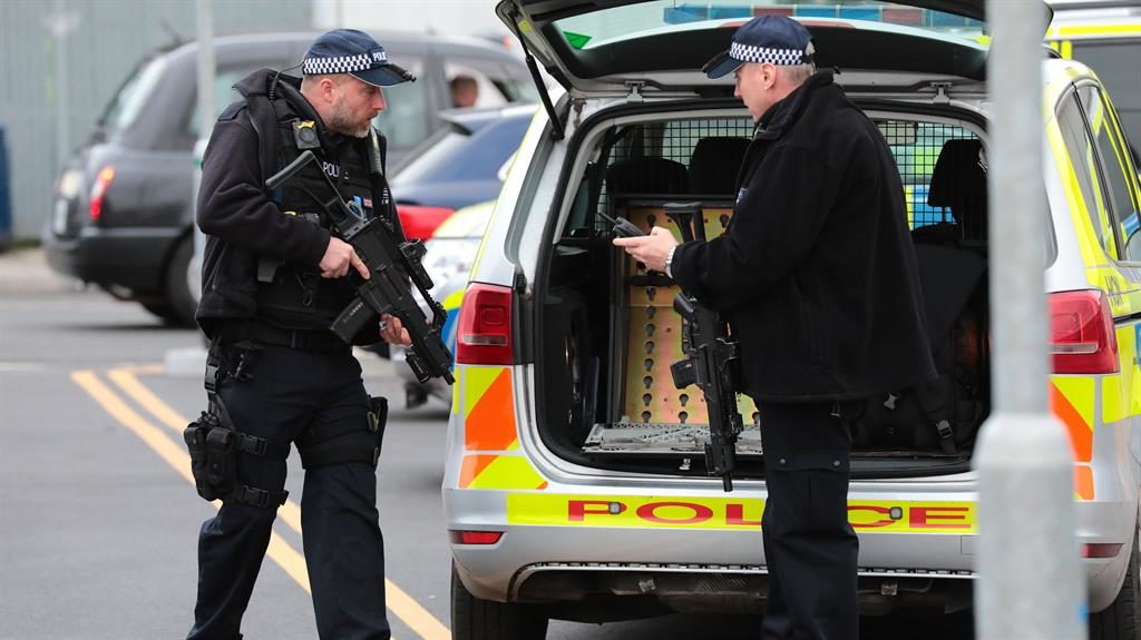 Alert: An armed officer at City Airport after parcel find PICTURE: LNP