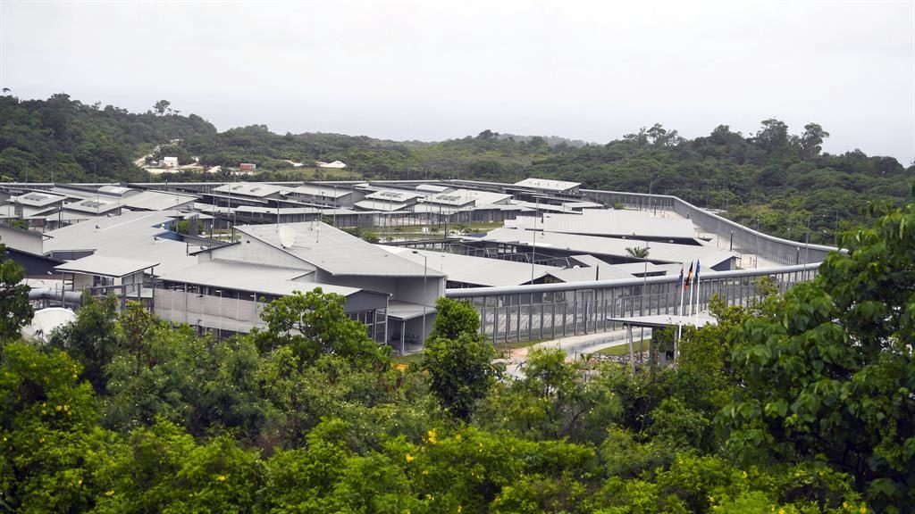 PM's visit puts reopening of Christmas Island detention centre in the spotlight