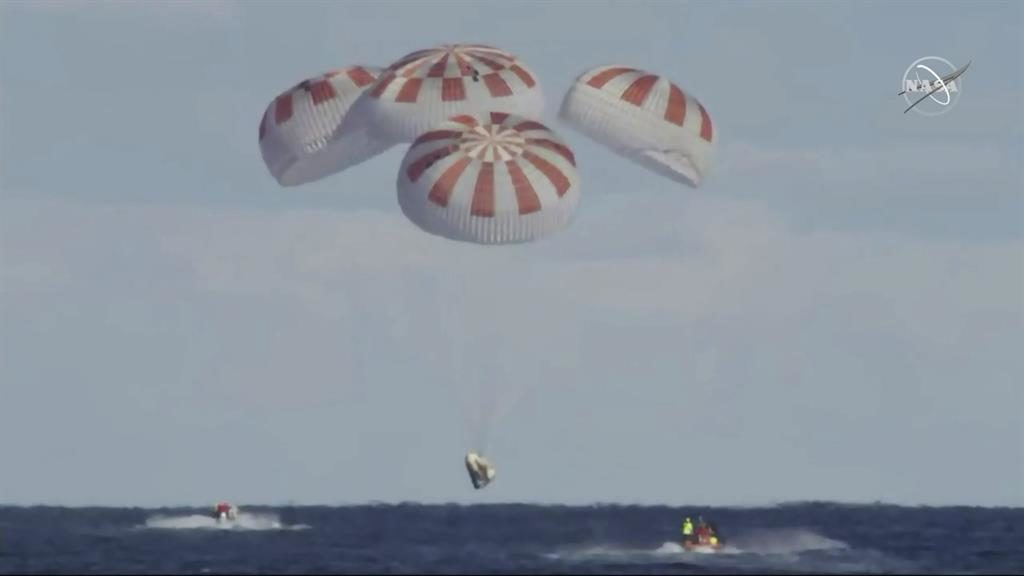 SpaceX's Crew Dragon splashes back to Earth after debut flight