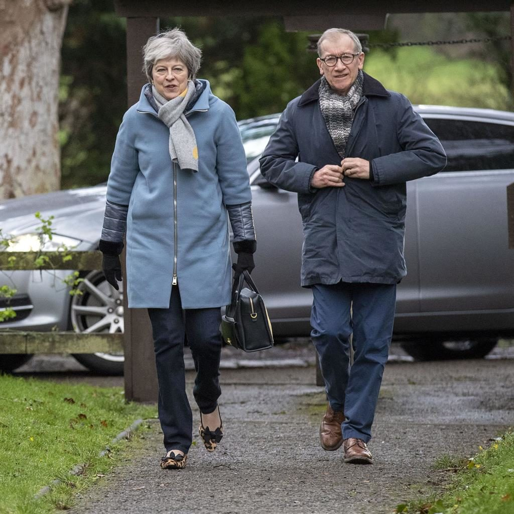 Living on a prayer? Theresa and Philip May arrive at church PIC: STEVE PARSONS/PA