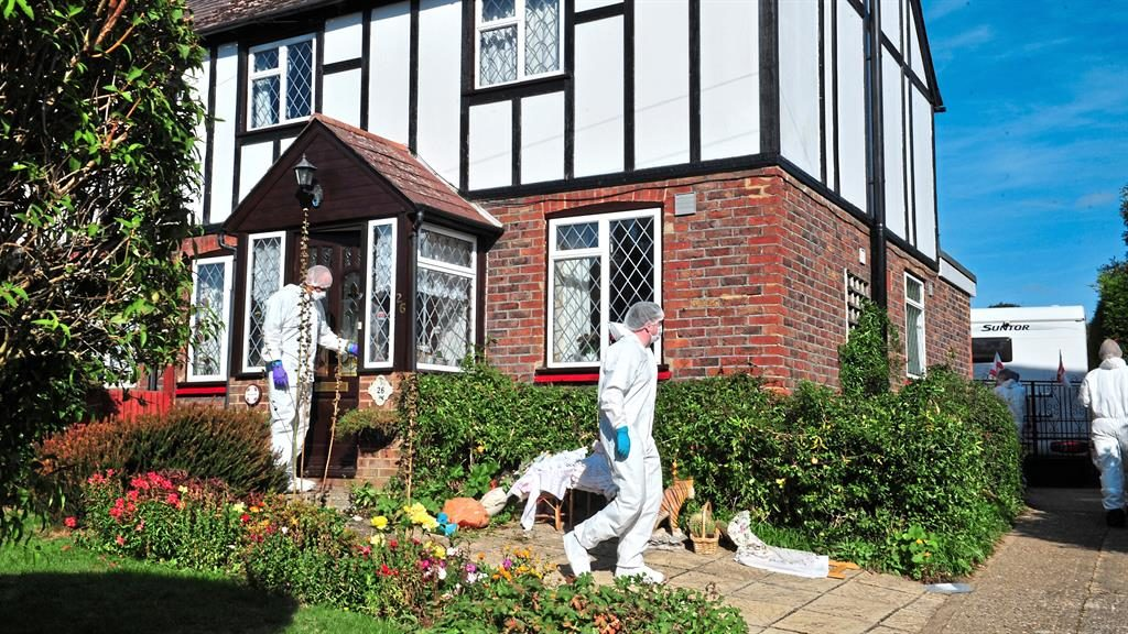 'Blood everywhere': Forensics officers at the house in Hadlow, Kent, after David Harris alerted police PICTURE: LNP
