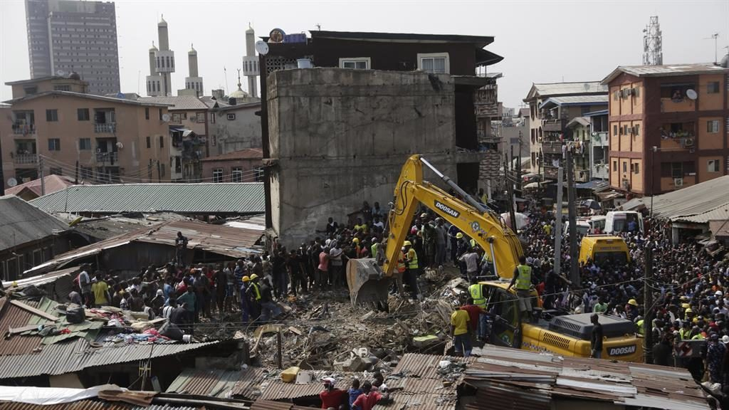 Frantic efforts: Rescuers work on clearing the rubble to reach trapped children PICTURE: SUNDAY ALAMBA/AP