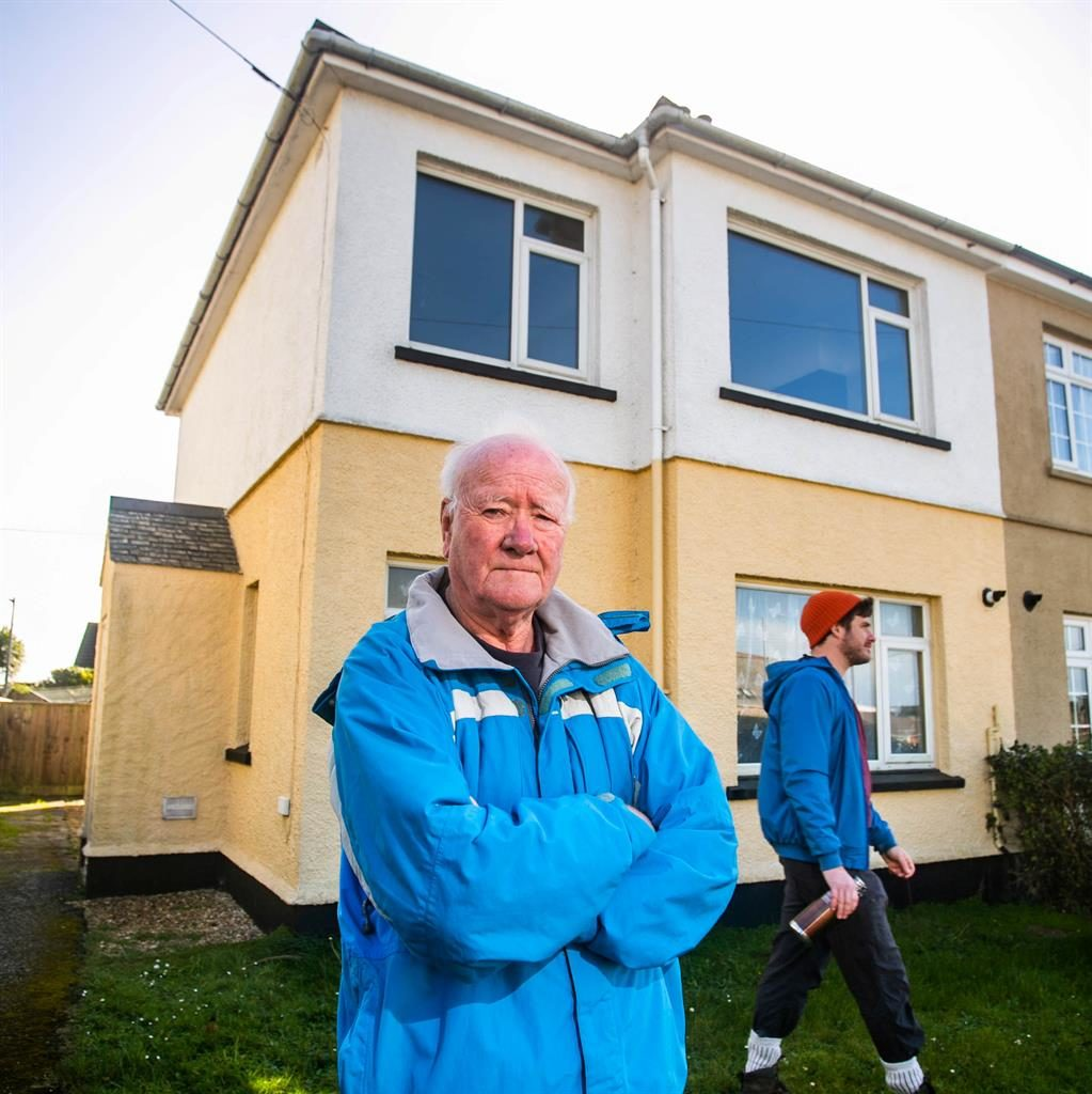 Ramble on: A 'walker' follows the route of the former path (for illustration purposes) behind homeowner Frank Barnett PICTURES: SWNS