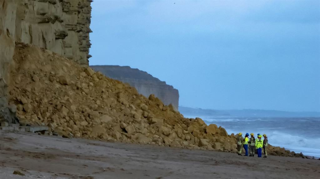 Rubble: Emergency crews at West Bay, Dorset, after 1,000 tons of rock fell at TV show site PICS: ANGLING CENTRE WEST BAY/ SWNS