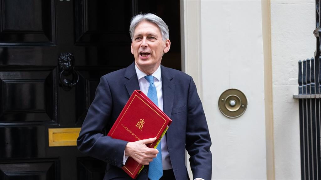 Fearful Phil: Philip Hammond leaves Downing Street on his way to deliver Brexit warnings in his Spring Statement PICTURE: REX