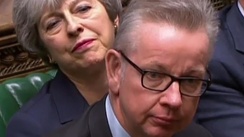 Spokesman: Michael Gove helps Theresa May after she lost her voice PICTURE: GETTY