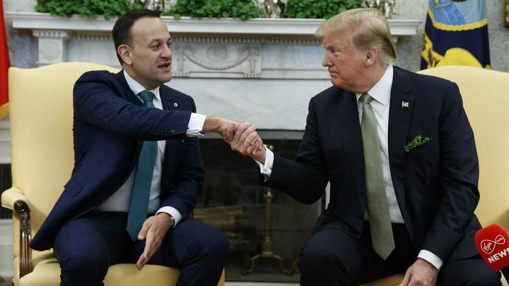 Helping hand: Donald Trump welcomes Leo Varadkar to the White House PICTURE: AP