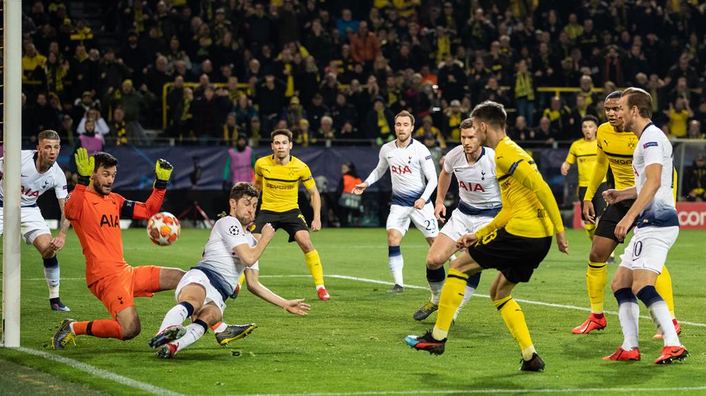 Orange wall Lloris gets down low to deny Julian Weigl one of a number of impressive saves from the goalkeeper