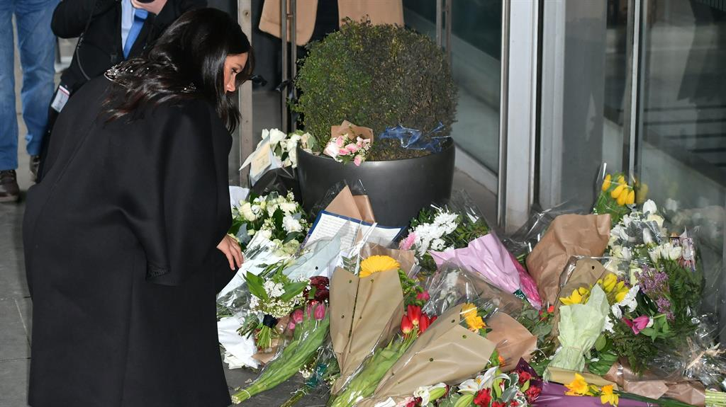 Compassion Meghan lays a bouquet during visit to New Zealand House