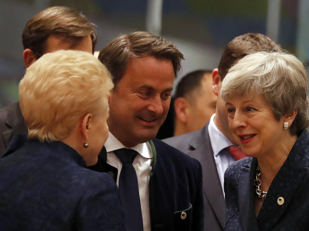 Talks Theresa May speaks with Luxembourg's prime minister Xavier Bettel at the summit