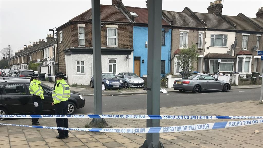 More violence: Police at the scene on Fairfield Road, Enfield, where a man suffered life-threatening injuries after being stabbed PICTURE: PA
