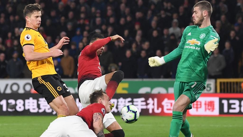 Tangle: United keeper De Gea is powerless as the ball bounces in off Smalling (centre), while Fulham boss Scott Parker faces up to relegation (below)