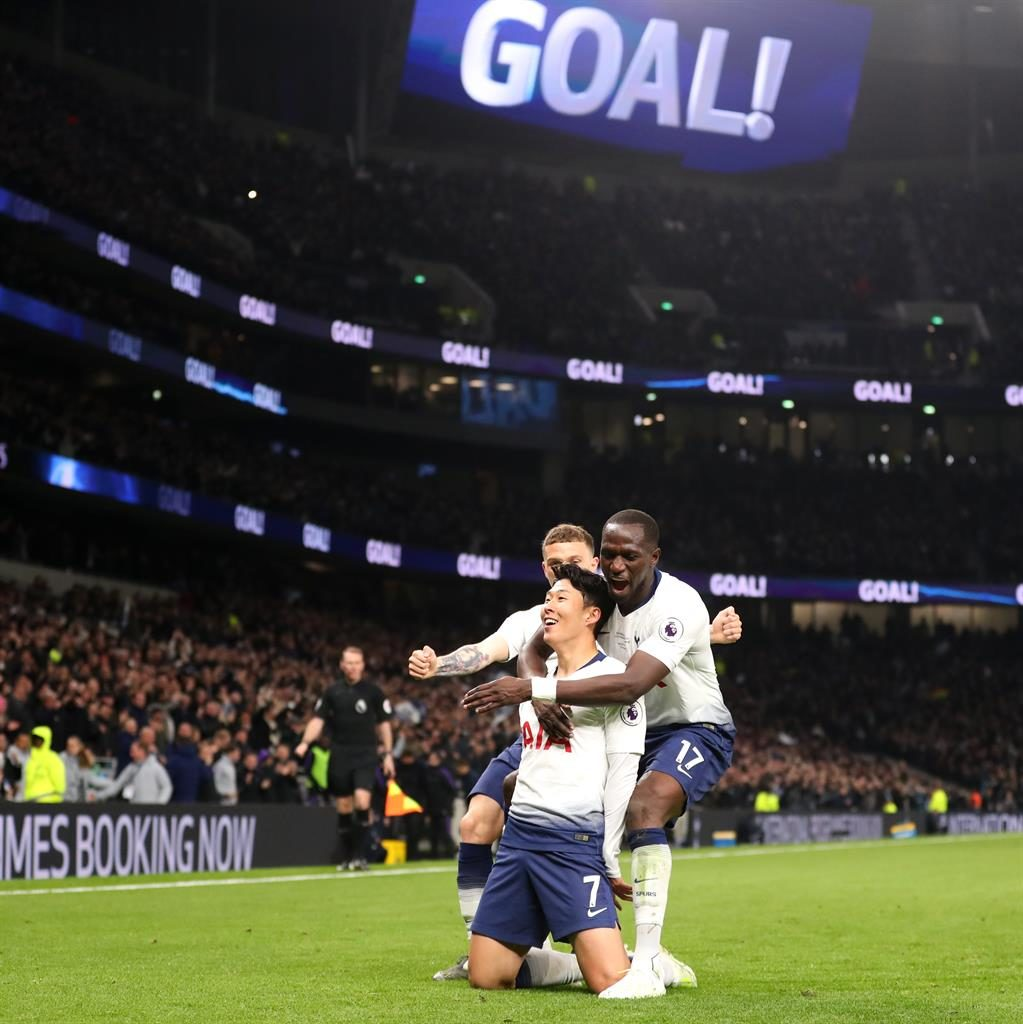 House-warming gift: Son celebrates his strike with Kieran Trippier and Moussa Sissoko before Eriksen (below) fires home the second goal