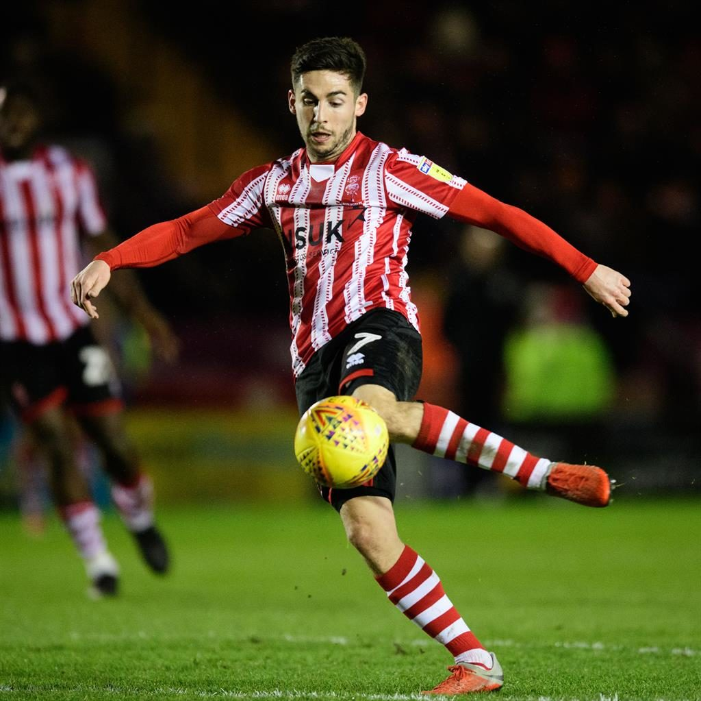 On the up: Pett has helped Lincoln into a commanding position in League Two PICTURE: GETTY
