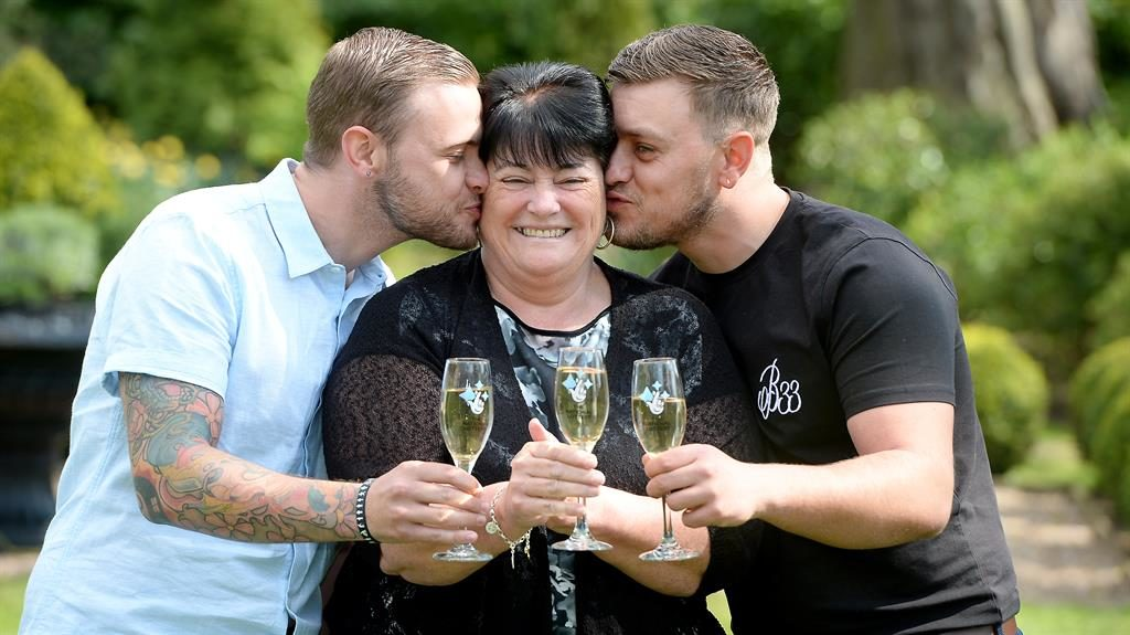 Mum in a million: Paula Williamson with sons Jack (left) and Ian toasting the win PICTURE: SWNS