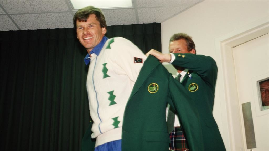 Nice fit: Sandy Lyle helps Faldo on with his green jacket while Hoch (below) can't believe he has missed PICTURES: GETTY