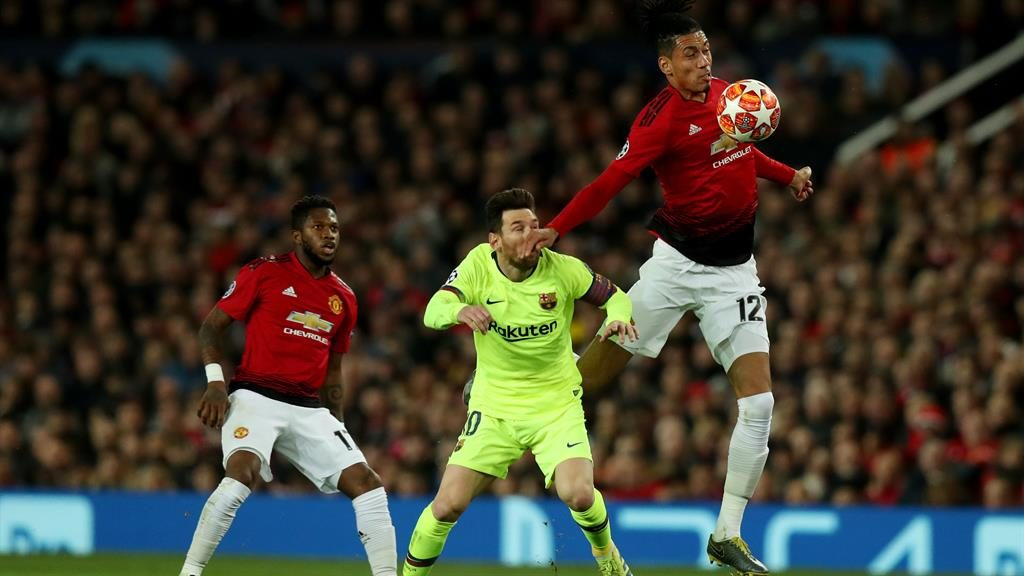 On the nose: Messi takes a painful blow from Smalling PICTURE: REX
