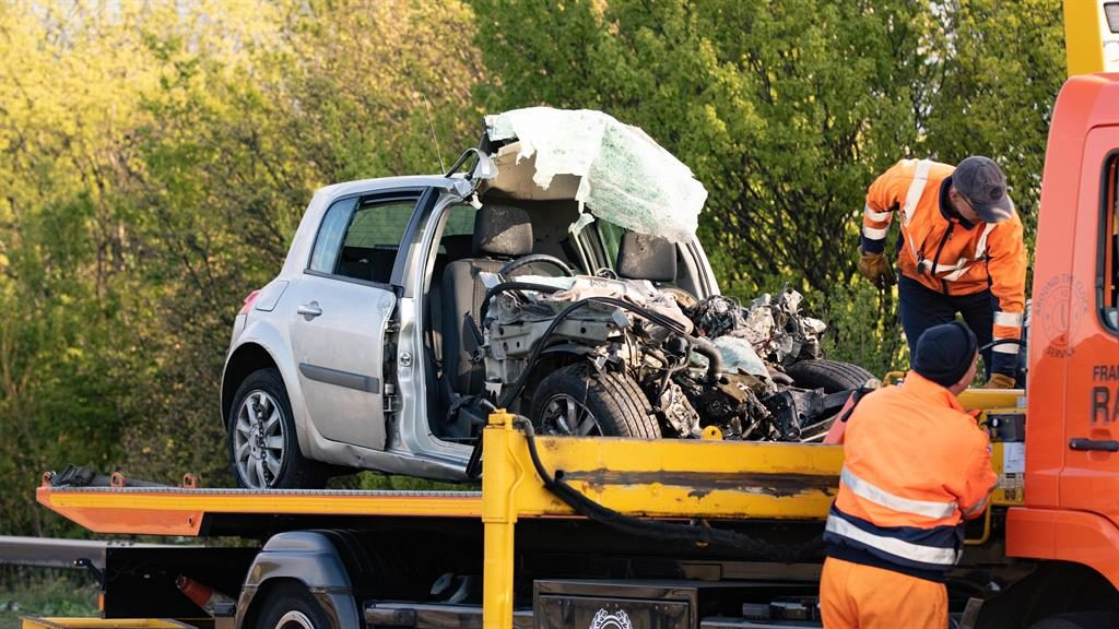 Wreckage: The silver car and pick-up truck (below) are loaded on to lorries PICTURES: TERRY HARRIS