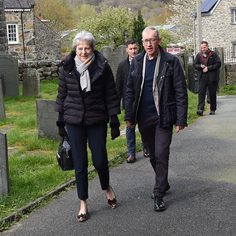 Break: Mr and Mrs May attend a Palm Sunday service at St Mary's Church in Dolgellau, north Wales PICTURE: ERFYL LLOYD DAVIES
