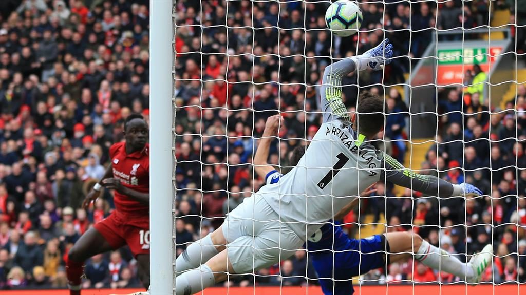 Opening line: Mane guides his header past Kepa Arrizabalaga PICTURE: GETTY