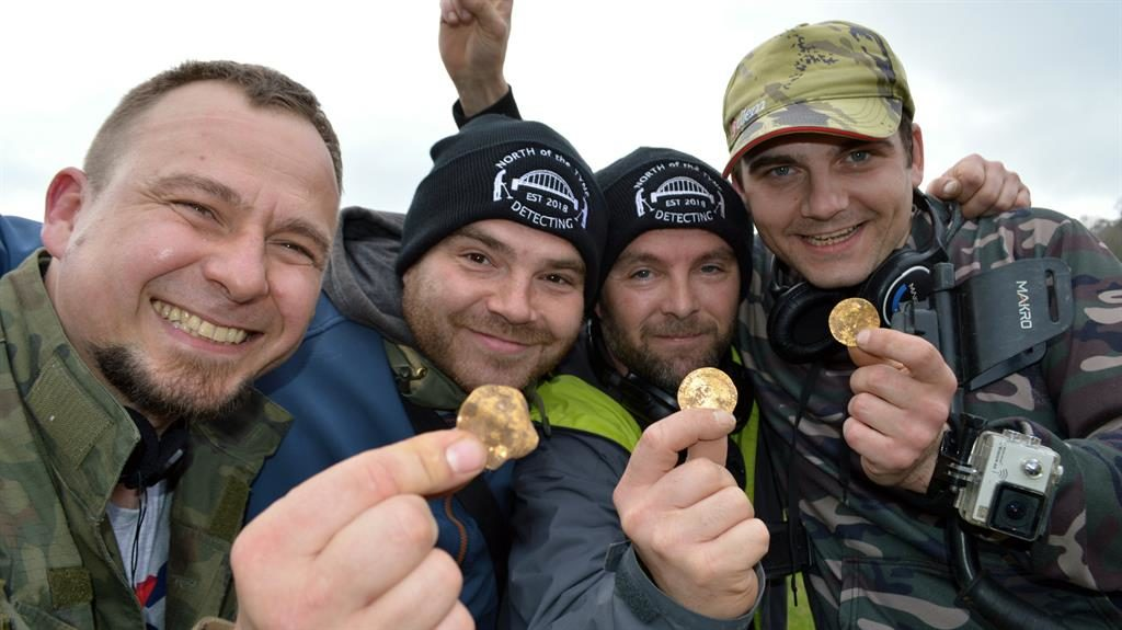 Struck gold: Dariusz Fijalkowski, Mateusz Nowak, Andrew Winter and Tobiasz Nowak, amateur metal detectorists who uncovered a hoard of 14th century coins in a field in Buckinghamshire PICTURES: SWNS