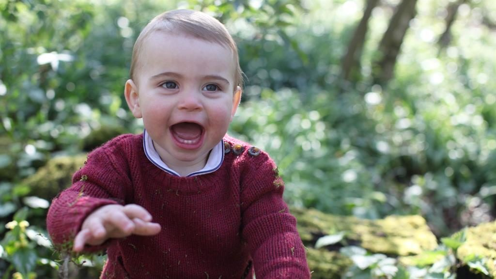 The white stuff: Louis reveals his first teeth — and a taste for action — in adorable photos in the garden PICTURE: THE DUCHESS OF CAMBRIDGE