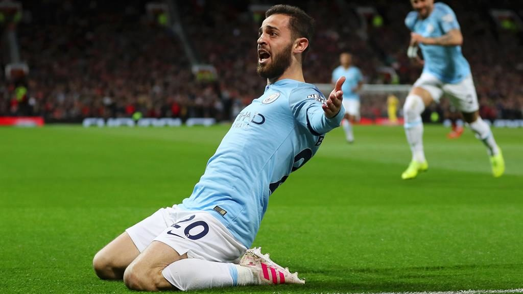 Knee-sy does it: Bernardo opened the scoring for Manchester City at Old Trafford while Neves (below) was on target for Wolves against Arsenal PICTURES: GETTY