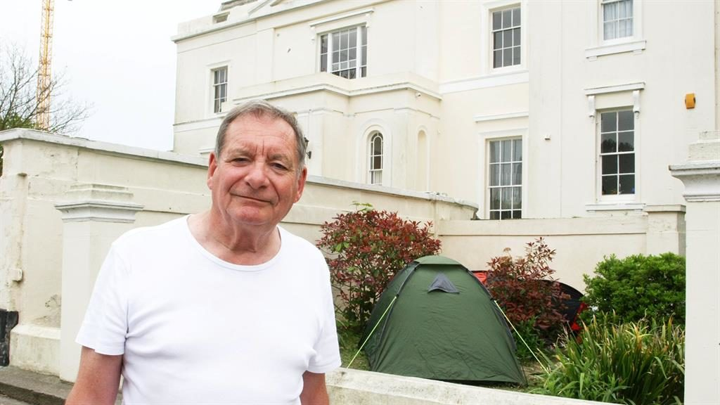 Garden camp: Robin Biggs and tents pitched at Grade II* listed Beach House PICTURE: SWNS