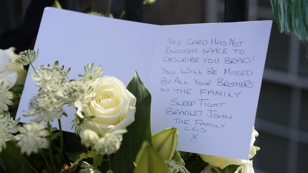 Outpouring of sympathy Tributes left at the scene close to where Welsh was gunned down