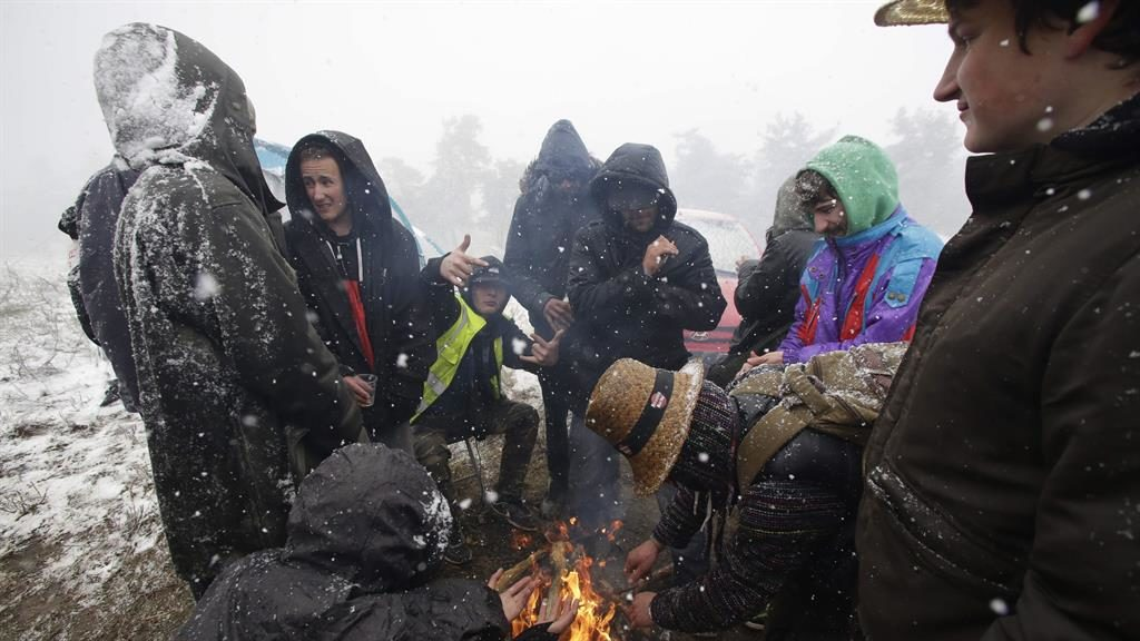 Chilling out: Ravers try to keep warm around a campfire at Teknival PICTURES: AFP/GETTY