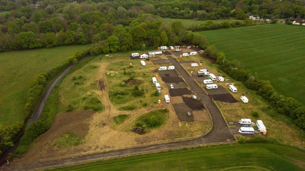 Building blot: New gravel roads lead to caravans pitched on the field near the exclusive village of Little Hadham PICTURE: SWNS