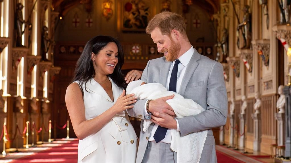 Magic moment: Harry holds dozing Archie as Meghan giggles in St George's Hall PICTURE: GETTY