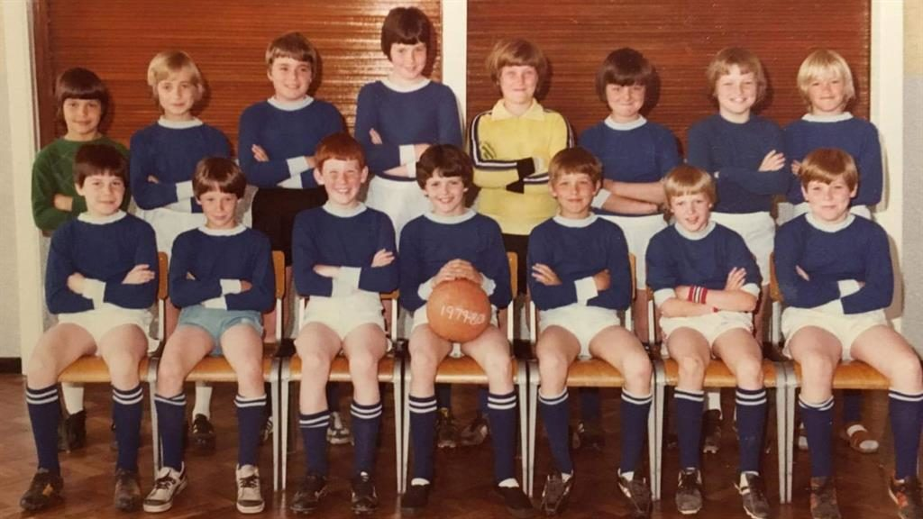 Line-up: The 1979 squad and (below) 40 years later, with Kevin Bennett holding the ball PICTURES: MALCOLM HART/SWNS
