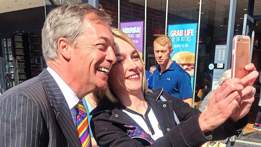 In the picture: Nigel Farage poses for a selfie on a walkabout in Pontefract, West Yorkshire, yesterday PICTURE: PA