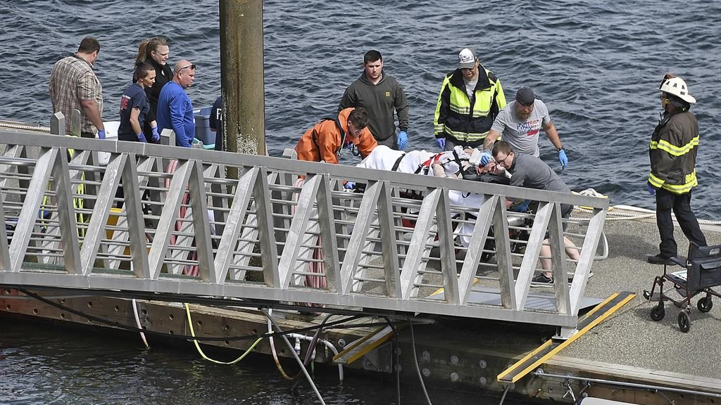 Rescue: Emergency crews transport an injured passenger to an ambulance PICTURE: AP