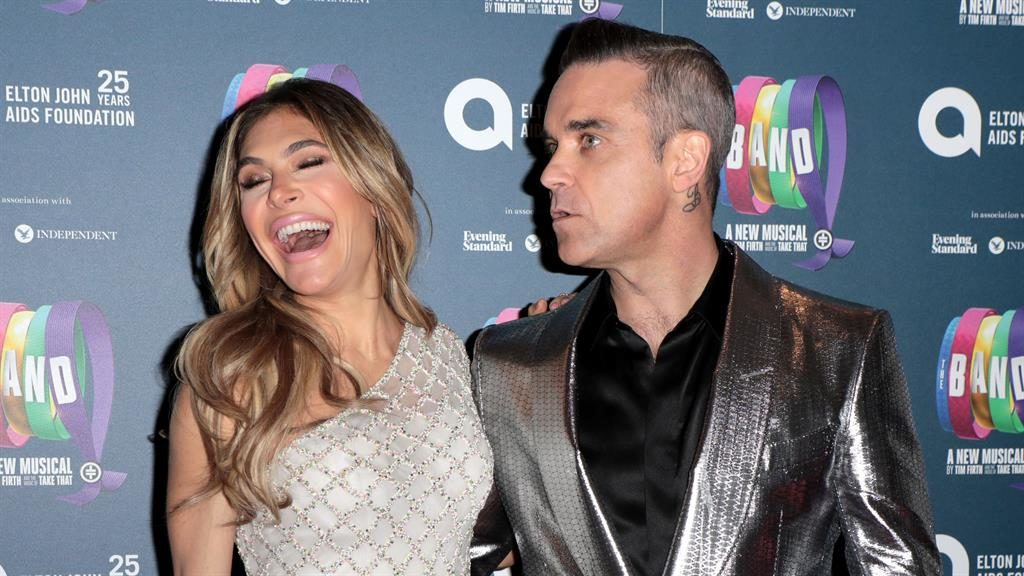 She's The (natural) One: Robbie hit out at fan who trolled Ayda over pout PICTURE: REX