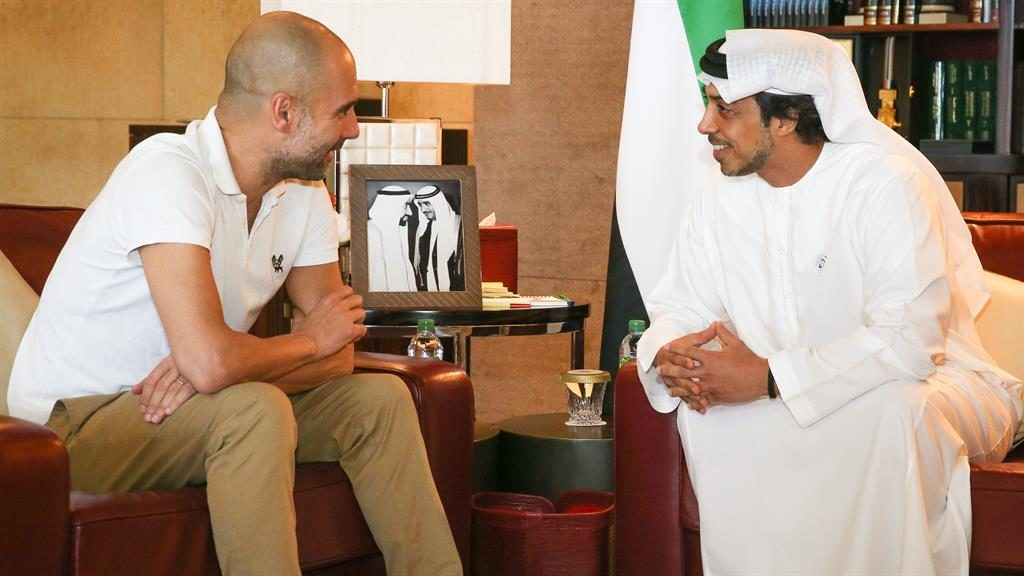 Owner: Sheikh Mansour (right) with City boss Pep Guardiola