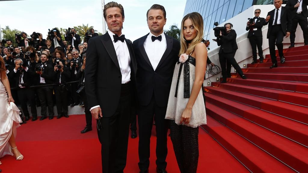 Cannes opening: Pitt (left) with DiCaprio and Margot Robbie last night. Below; Tarantino with wife Daniela PICTURES: EPA