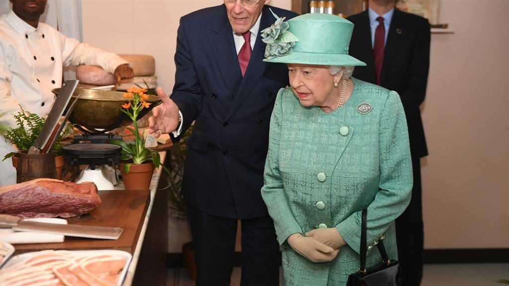 Royal visit: The Queen views one of the displays at a replica of an original Sainsbury's PICS: PA/REX