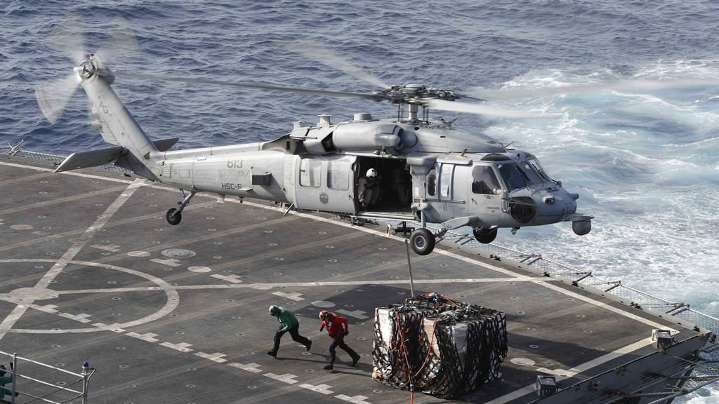 Acton stations: A helicopter delivers supplies to USS Abraham Lincoln carrier