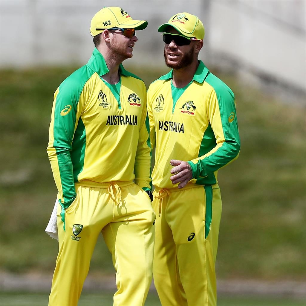 Back in the fold: Smith (left) and Warner