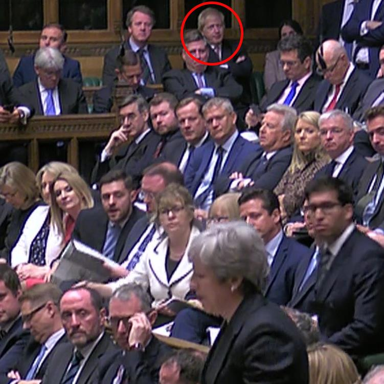 Eye on the top job: Mrs May addresses the Commons as Boris Johnson (circled) looks on PICTURE: PIXEL