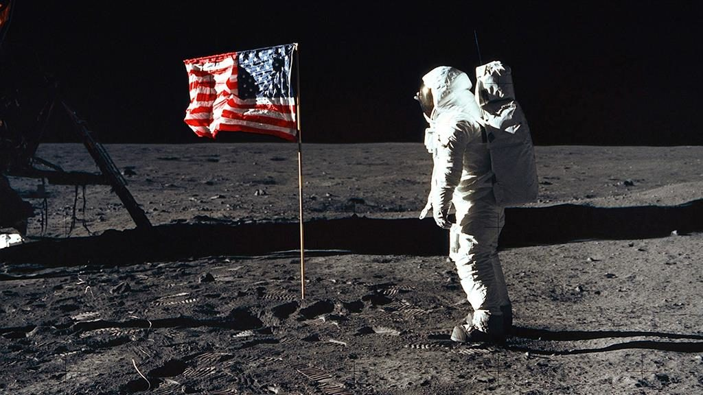 Territorial claim? US astronaut Buzz Aldrin salutes the American flag PICTURE: CANADIAN PRESS/REX/SHUTTERSTOCK