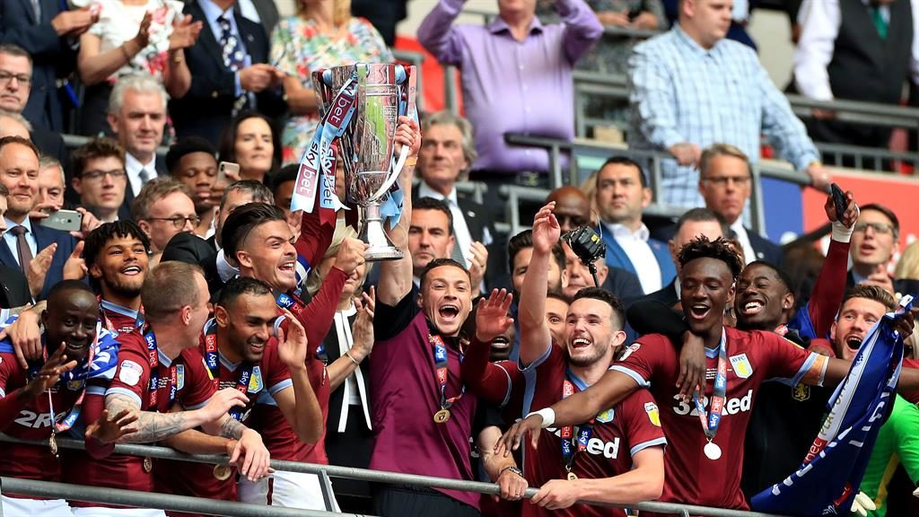 Shining example: Grealish and James Chester lift the trophy after Villa's victory at Wembley PICTURE: PA