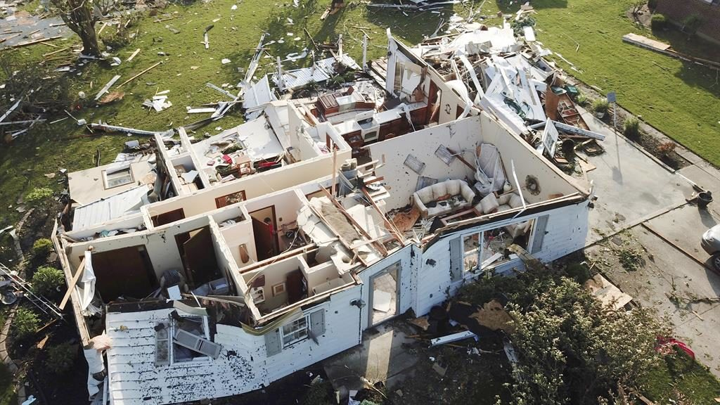 It's a rip-off: The roof of this home was completely blown away in Celina PICTURES: AP