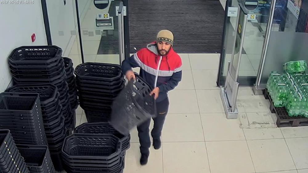 Caught on CCTV: Rachid Redouane is seen entering the supermarket